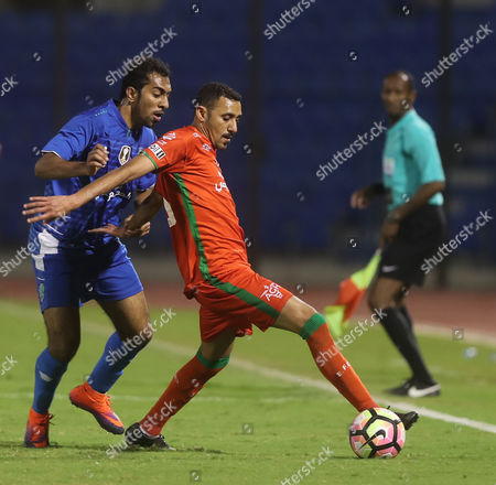Al-Fateh player Abdullah Al-Beladi (L) in action for the ball with Al-Ettifaq player Abdulaziz Al-Nashi (R) during the Saudi King's Cup soccer match between Al Ettifaq and Al-Fateh at Prince Mohammed bin Fahd Stadium, Dammam, Saudi Arabia, 24 February 2017.