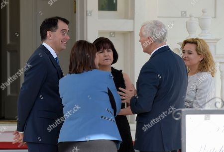 Mike Pence, Tonette Walker, Scott Walker, Charlotte Pence, Karen Pence Wisconsin Gov. Scott Walker, left, and his wife Tonette Walker, second from left, talk with Vice President Mike Pence, second from right, and his wife Karen, as they arrive for a luncheon with other governors at the Naval Observatory in Washington, . Pence's daughter Charlotte Pence is at right