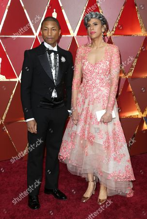 Pharrell Williams and Mimi Valdes