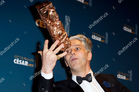 Actor James Thierree plays with the Cesar of Best Supporting actor award for 'Chocolat' during the 42nd Cesar Film Awards ceremony at Salle Pleyel in Paris,. This annual ceremony is presented by the French Academy of Cinema Arts and Techniques