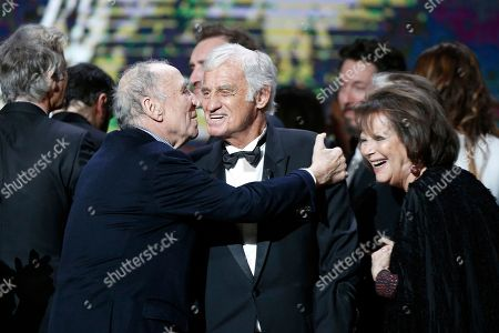 Jean Paul Belmondo, Claudia Cardinale, Claude Brasseur French actor Jean Paul Belmondo, center, is congratulated by Claudia Cardinale, right, and Claude Brasseur, left, during the ceremony of the 42nd Cesar Film Awards, at the Salle Pleyel, in Paris, France,. This annual ceremony is presented by the French Academy of Cinema Arts and Techniques