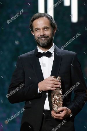 "Swiss film director Claude Barras smiles after he received the Best Animated Feature award for ""Ma vie de Courgette"" (My Life as a Courgette) during the ceremony of the 42nd Cesar Film Awards, at the Salle Pleyel, in Paris, France,. This annual ceremony is presented by the French Academy of Cinema Arts and Techniques"