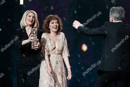 "French actress Alice Taglioni, left, and Italian actress Valeria Golino, center, give the Best Actor in a Supporting Role award to French actor James Thierree, right, for his performance in ""Chocolat"", during the 42nd Cesar Film Awards, at the Salle Pleyel, in Paris, France, . This annual ceremony is presented by the French Academy of Cinema Arts and Techniques"