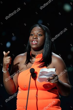 """French actress Deborah Lukumuena speaks on stage after she received the Best Actress in a Supporting Role award for """"Divines"""", during the 42nd Cesar Film Awards, at the Salle Pleyel, in Paris, France, . This annual ceremony is presented by the French Academy of Cinema Arts and Techniques"""