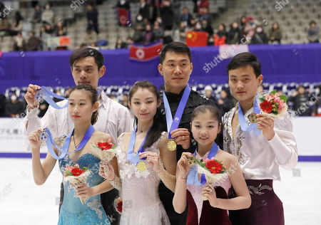 Yu Xiaoyu, Zhang Hao, Peng Cheng, Jin Yang, Ryom Tae Ok, Kim Ju Sik Gold medalists Yu Xiaoyu and Zhang Hao of China, center, are flanked by silver medalists Peng Cheng and Jin Yang of China, center, and bronze medalists Ryom Tae Ok and Kim Ju Sik of North Korea, left, during the victory ceremony of the Pair's of Figure Skating competition at Makomanai Indoor Skating Rink at the Asian Winter Games in Sapporo, northern Japan