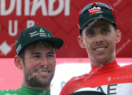 The new overall leader, Portuguese rider Rui Costa (R) of the UAE Team Emirates  and the points classification leader, British rider Mark Cavendish of Team Dimension Data pose on the podium after third stage of the Abu Dhabi Tour cycling race, 25 February 2017.
