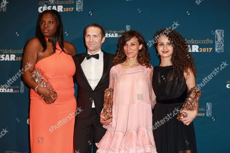 (L-R) Deborah Lukumuena 'Cesar of Best supporting actress', Guest, Houda Benyamina 'Cesar of best first feature film', and Oulaya Amamra 'Cesar of the best promising actress' for 'Divines'