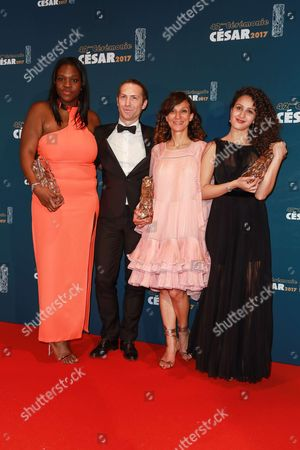 Stock Image of (L-R) Deborah Lukumuena 'Cesar of Best supporting actress', Guest, Houda Benyamina 'Cesar of best first feature film', and Oulaya Amamra 'Cesar of the best promising actress' for 'Divines'