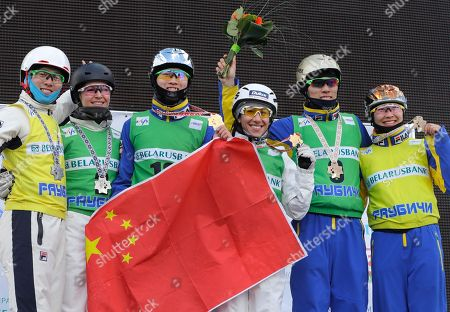 Guangpu Qi, Danielle Scott, Xindi Wang, Lydia Lassila, Hang Zhou, Mengtao Xu From left, second placed Guangpu Qi of China, and Danielle Scott of Australia, winners Xindi Wang of China, and Lydia Lassila of Australia, and third placed Hang Zhou and Mengtao Xu of China, stand on a podium celebrating their victory in the FIS Freestyle Ski World Cup 2017 event in Raubichi, on the outskirts of Minsk, Belarus