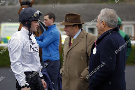 David Mullins, Nicky Henderson and owner Michael Buckley after Brain Power had won a racecourse gallop at Kempton.