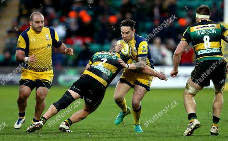 Ryan Lamb of Worcester Warriors is tackled by Mikey Haywood of Northampton Saints