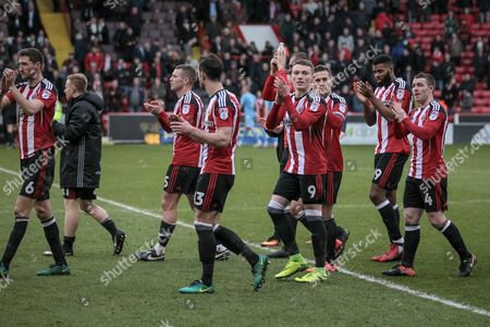 Chris Basham (Sheffield United), Paul Coutts (Sheffield United), Jake Wright (Sheffield United), Caolan Lavery (Sheffield United), John Fleck (Sheffield United), Ethan Ebanks-Landell (Sheffield United) and Billy Sharp (Captain) (Sheffield United) walk around the ground applauding the fans after the EFL Sky Bet League 1 match between Sheffield Utd and Bolton Wanderers at Bramall Lane, Sheffield
