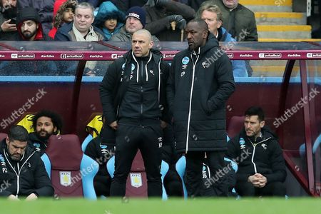 Kevin Phillips, Derby County coach and Chris Powell, assistant manager, on the touchline