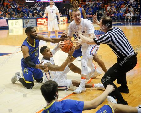 Brandon Mitchell, Paris Austin, James Reid San Jose State's Brandon Mitchell (4) and Boise State's Paris Austin, on floor, and James Reid all look to the referee as they fight over the ball during the second half of an NCAA college basketball game in Boise, Idaho, . Boise State won 85-78