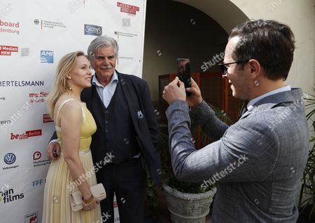Stock Picture of German actorTrystan Putter (R) takes pictures of Dutch actress Hadewych Minis (L) and Austrian actor Peter Simonischek (C) from the Oscar-nominated movie 'Toni Erdmann' at the Oscar reception for German Oscar nominees at the Villa Aurora in Pacific Palisades, California, USA, 25 February 2017.  The Academy Awards, also known as the Oscars, will take place in Hollywood on 26 February 2017.