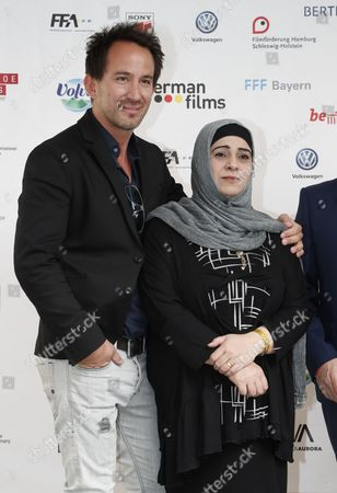 German documentary filmmaker Marcel Mettelsiefen (L) and Hala Kamil (R) from Syria whose film 'Watani-My Homeland' is nominated for Best Documentary Short Film pose at the Oscar reception for German Academy Awards at the Villa Aurora in Pacific Palisades, California, USA, 25 February 2017. The Academy Awards, also known as the Oscars, will take place in Hollywood on 26 February 2017.