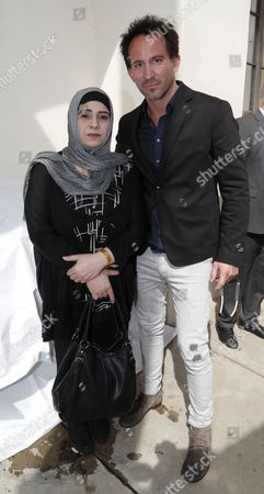 Stock Photo of German documentary filmmaker Marcel Mettelsiefen (R) and Hala Kamil (L) from Syria whose film 'Watani-My Homeland' is nominated for Best Documentary Short Film pose at the Oscar reception for German Academy Awards at the Villa Aurora in Pacific Palisades, California, USA, 25 February 2017. The Academy Awards, also known as the Oscars, will take place in Hollywood on 26 February 2017.