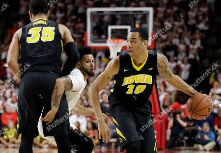 Cordell Pemsl, Jaylen Brantley, Christian Williams Iowa guard Christian Williams, right, drives past Maryland guard Jaylen Brantley, center, as Brantley is screened by Iowa forward Cordell Pemsl in the first half of an NCAA college basketball game, in College Park, Md