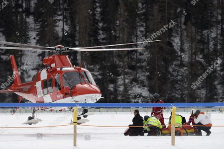 Jockey George Baker is transported to a hospital by helicopter after crashing during the GP Moyglare Stud, on the frozen Lake on the third weekend of the White Turf horse races in St. Moritz, Switzerland, 26 February 2017. The races were cancelled afterwards due to a crack in the ice.