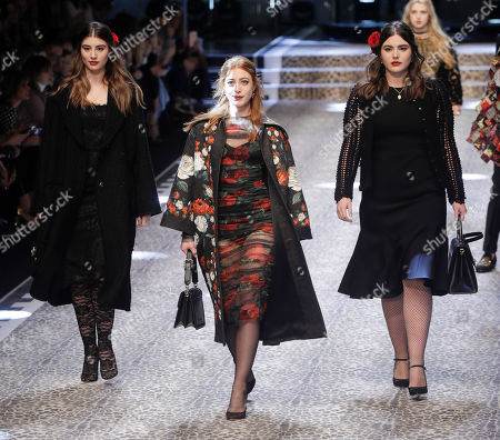From left, Dominik, Daniella and Alessandra Garcia-Lorido daughters of actor Andy Garcia wear creations for Dolce&Gabbana women's Fall-Winter 2017-18 collection, in Milan, Italy