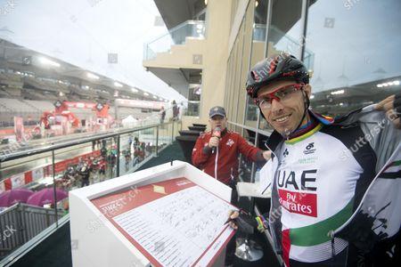 Portuguese rider Rui Costa of UAE Team Eirates on the podium signature of the fourth stage of Abu Dhabi Tour 2017 cycling race at Yas Marina Circuit. Abu Dhabi, 26 February 2017.