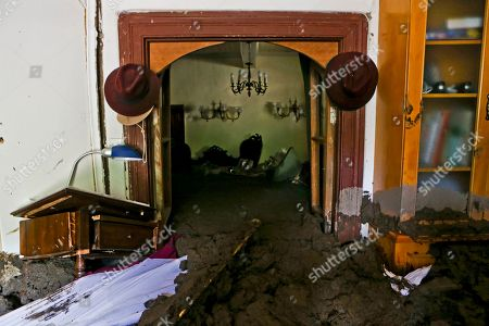 Stock Image of Sludge fills the home of Gabriel Lopez, brought by the overflowing of the Estero San Jose River in San Alfonso, Santiago, Chile, . Floods caused by Andean rainfall are causing havoc in parts of Chile, triggering landslides, cutting roads and isolating thousands of people