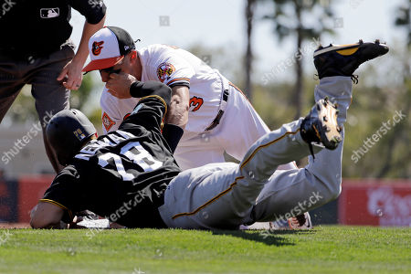 Kevin Newman, Ryan Flaherty Pittsburgh Pirates' Kevin Newman, bottom, is out at third base on the tag by Baltimore Orioles' Ryan Flaherty on a single by the Pirates' Jason Rogers in the third inning of an exhibition spring training baseball game in Sarasota, Fla., . Baltimore won 8-3