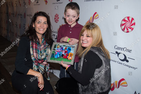 IMAGE DISTRIBUTED FOR CAREONE MANAGEMENT - Nancy Kerrigan, left, greets families who were granted wishes through Make-A-Wish New Jersey at CareOne's 200 Wishes event, on in Newark, N.J