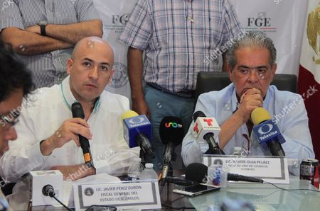 Attorney General of  the Mexican state of Morelos, Javier Perez Duron (L), and Attorney General of  the Mexican state of Guerrero, Xavier Olea (R), during a press conference in Acapulco, Mexico, 26 February 2017. The  Guerrero Attorney General?s office announced an investigation into the disappearance of seven cowboys who were last seen on 17 February 2017 when they were headed to compete in a rodeo in San Miguel Totolapan, Mexico.