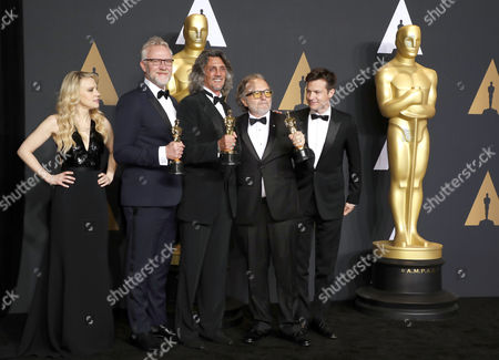 Presenters Kate McKinnon (L) and Jason Bateman (R) pose with makeup artists Giorgio Gregorini (2nd from L), Alessandro Bertolazzi (C) and Christopher Allen Nelson (2nd from R), winners of the award for Makeup and Hairstyling for 'Suicide Squad,' pose for photographs in the press room during the 89th annual Academy Awards ceremony at the Dolby Theatre in Hollywood, California, USA, 26 February 2017. The Oscars are presented for outstanding individual or collective efforts in 24 categories in filmmaking.