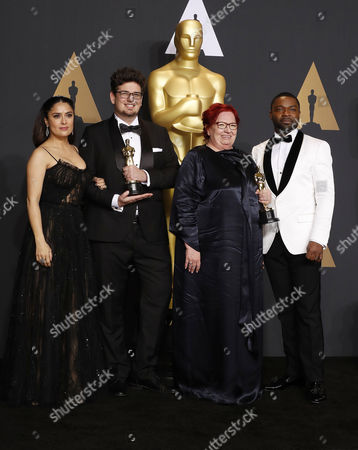 Kristof Deak (L) and Anna Udvardy,  winners of the award for Best Live Action Short Film for 'Sing,' pose with Salma Hayek (L) and David Oyelowo (R) in the press room during the 89th annual Academy Awards ceremony at the Dolby Theatre in Hollywood, California, USA, 26 February 2017.  The Oscars are presented for outstanding individual or collective efforts in 24 categories in filmmaking.