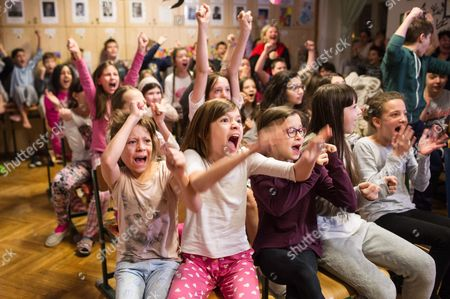 Members of the choir of the Bakats Ter Primary and Music school, cast members of Oscar nominated film in short film category 'Sing' (Mindenki) by Hungarian movie director Kristof Deak, celebrate as they watch the broadcasting of the 89th annual Academy Awards ceremony from Hollywood, California, USA, at their school in Budapest, Hungary, early 27 February 2017. Deak's film won the Oscar award in the Best Live Action Short Film category.