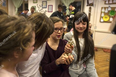 Members of the choir of the Bakats Ter Primary and Music school, cast members of Oscar nominated film in short film category 'Sing' (Mindenki) by Hungarian movie director Kristof Deak, celebrate with a mini Oscar statuette as they watch the broadcasting of the 89th annual Academy Awards ceremony from Hollywood, California, USA, at their school in Budapest, Hungary, early 27 February 2017. Deak's film won the Oscar award in the Best Live Action Short Film category.