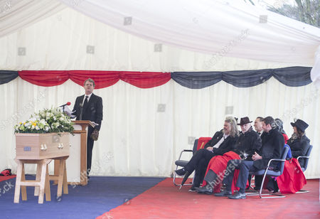 Comedian Paul Merton, with Alan Simpson's comedy writing partner Ray Galton (front row, 2nd right), gives a speech at the farewell ceremony of British comedy writer Alan Simpson on the pitch at Hampton and Richmond Football club, Hampton, South West London, where he was Club President and involved with the club for 50 years.
