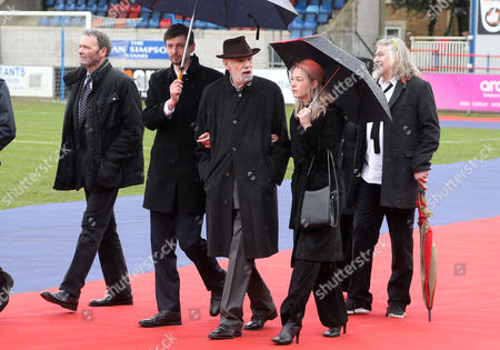 Comedy writing partner of Alan Simpson, Ray Galton (centre, hat) attends a farewell ceremony to British comedy writer Alan Simpson on the pitch at Hampton and Richmond Football club, Hampton, South West London, where he was Club President and involved with the club for 50 years.