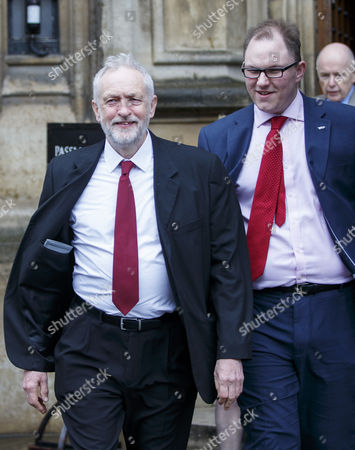 Labour leader Jeremy Corbyn and Labour's Gareth Snell come out the parliament to be welcomed by Labour MPs outside the parliament, after his victory in Stoke-on-Trent Central by-election.
