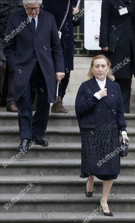 Fashion designer Miuccia Prada and her husband Patrizio Bertelli leave the Duomo gothic cathedral after attending a memorial mass for late Vogue Italia editor-in-chief Franca Sozzani, in Milan, Italy