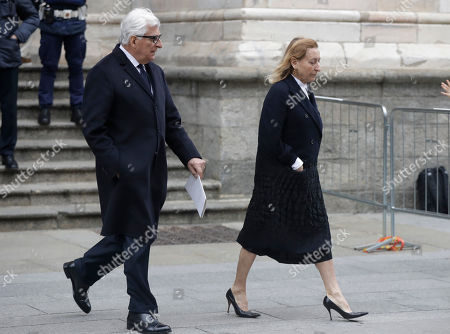 Fashion designer Miuccia Prada is flanked by her husband Patrizio Bertelli as they leave the Duomo gothic cathedral after attending a memorial mass for late Vogue Italia editor-in-chief Franca Sozzani, in Milan, Italy