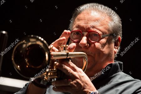 Cuban jazz player Arturo Sandoval plays during a concert in Moscow, Russia, . AP Photo/Alexander Zemlianichenko