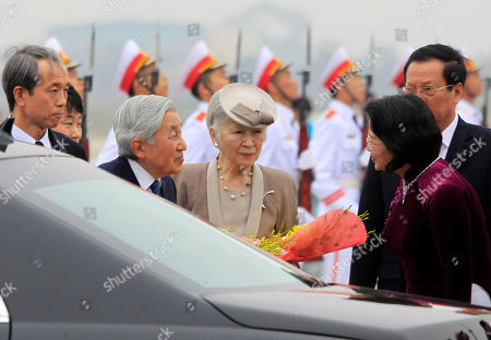 Akihito, Michiko, Dang Thi Ngoc Thinh Japan's Emperor Akihito, second from left, and Empress Michiko speak to Vietnamese Vice President Dang Thi Ngoc Thinh, right, at Noi Bai airport in Hanoi, Vietnam, . The royal couple arrive in Hanoi for a goodwill visit where they will meet with the abandoned wives of former Japanese soldiers from World War II