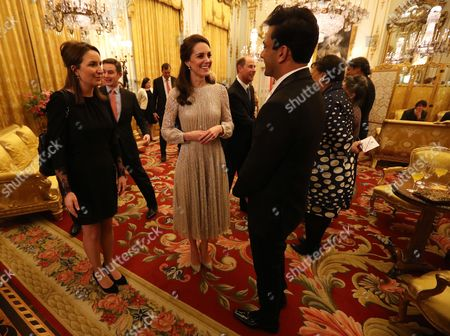 Catherine Duchess of Cambridge speaks to chef Vikas Khanna (right), who is one of the presenters of MasterChef India, at a reception to mark the launch of the UK-India Year of Culture 2017 at Buckingham Palace, London.