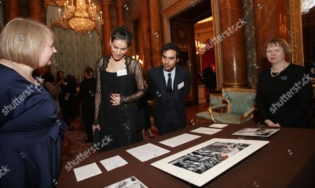 Neha Kapur and Kunal Nayyar look at a display from the Royal Collection during a reception to mark the launch of the UK-India Year of Culture 2017 at Buckingham Palace, London.