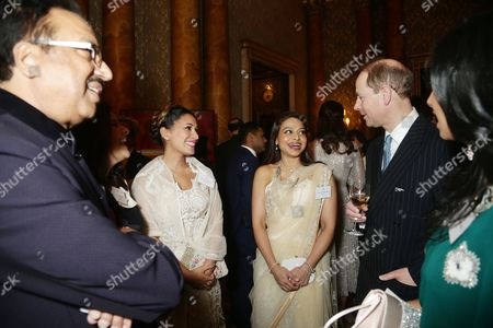 The Prince Edward (left) speaks to Ayesha Dharker (centre) during a reception to mark the launch of the UK-India Year of Culture 2017 at Buckingham Palace, London.