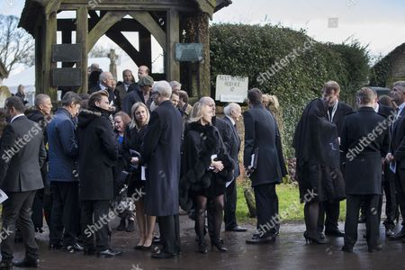 Mourners comfort each other