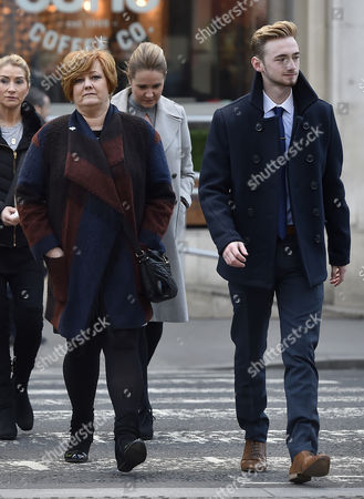 Relatives of victims of the Tunisia terror attack, including survivor Owen Richards (R) and his mother Suzanne Evans (L), arrive for the inquest at Royal Courts of Justice in London, Britain, 28 February 2017. An inquest into the attack by a gunman on a Tunisian beach in June 2015, which left 38 people dead, is underway at the Royal Courts of Justice in London. Owen Richards' older brother Joel, his uncle Adrian Evans and grandfather Patrick Evans were all killed in the attack.