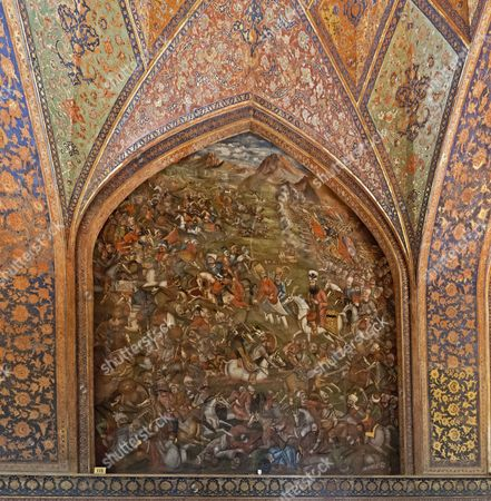 Iran, Isfahan/Esfahan, Safavid-period Chehel Sotun Palace (Kakh-e Chehel Sotun), a pleasure pavilion and reception hall, originally built in the 17th century by Shah Abbas II and rebuilt in 1706 after a fire; main reception hall, with wall paintings - here the battle of Chaldoran (or Chaldiran) in 1518 where the Safavid Shah Ismail I was defeated by the Ottoman Sultan Selim I
