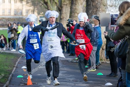 Tim Loughton MP (centre), Lord Porter CBE (L) and Financial Times journalist George Packer (R) battle it out during the annual Parliamentary Pancake Race.