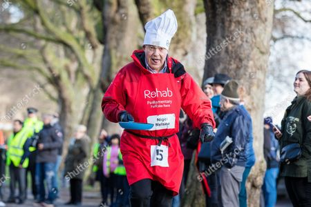 Sunday Mirror journalist Nigel Nelson races down the home straight in the annual Parliamentary Pancake Race.