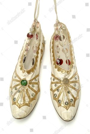 Stock Image of Shoes made in India worn by ballerina Anna Pavlova for a 'Ballet in Three Miniatures', first performed at the Royal Opera House Covent Garden on September 13, 1923. Music was by Henry Geehl, decor by Allegri and choreography by Fijima and Fumi, Professors of Dancing in Tokyo. 'A Hindu Wedding' and 'Krisha and Rhada' had music by Comolata Banerji, costumes brought from India, decor by Allegri based on Hindu miniatures and choreography by Uday Shankar