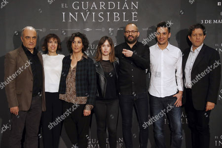 (L-R) Actors Francesc Orella, producer Mercedes Gamero, Elvira Minguez, Marta Etura, film director Fernando Gonzalez Molina, Carlos Librado and Pedro Casablanc pose during the premiere of the Spanish movie 'El Guardian Invisible' (The Invisible Guardian) in Madrid, Spain, 28 February 2017. The film is based on the first volume of the trilogy 'Baztan' of Spanish writer Dolores Redondo.